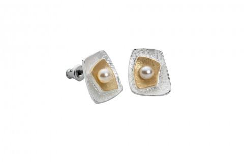 Perle auf Gold und Silber